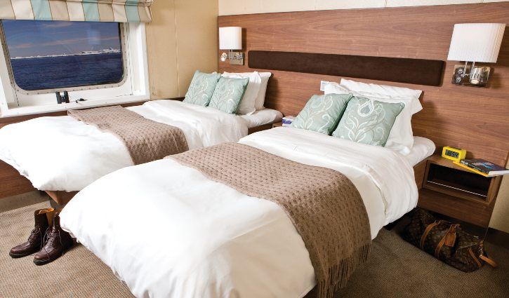 Category 4 double cabin with window aboard National Geographic Explorer.